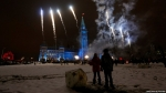 Children watch fireworks during a Christmas light ceremony on Parliament Hill in Ottawa.